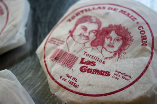 The tortilla packages bear an image of Alex Gama's parents.
