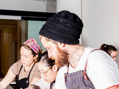 Laura Higgins-Baltzley (far left), Brandon Baltzley (center) at the winter CRUX dinner