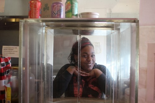 Mack's granddaughter spontaneously posed in the bulletproof carousel.