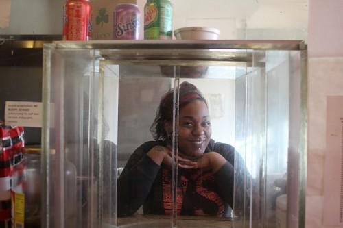 Mack's granddaughter spontaneously posed in the bulletproof carousel.