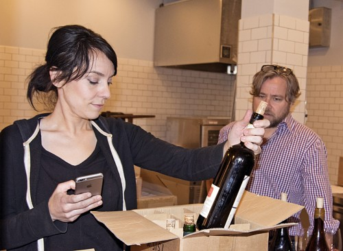 Cara Sandoval checks in a shipment of wine