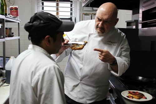 Trained in the traditional ways of French kitchens, Chef Dominique gently instructs his cook in some of the finer points of making toast a la Française.
