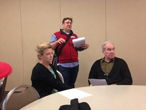 Tanya Nueske and David Hammond listen as Baconfest co-founder Seth Zurer instructs the judges.