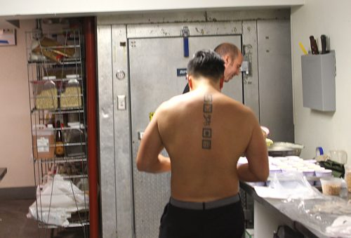 Chef Thai's pictogram tattoos—the center being the logo for El Bulli