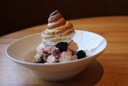 "Beso de angel (""kiss of the angel""), fresh berries on walnut crumble, ice cream, toasted marshmallow meringue"