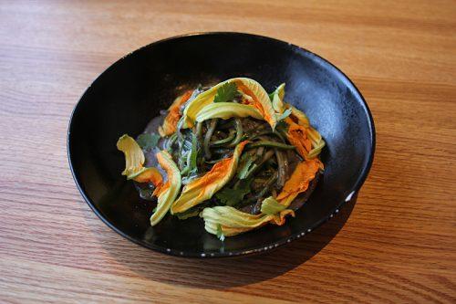 """Zucchini fideos with zucchini """"pasta,"""" huitlacoche, squash blossoms, cotija cheese"""