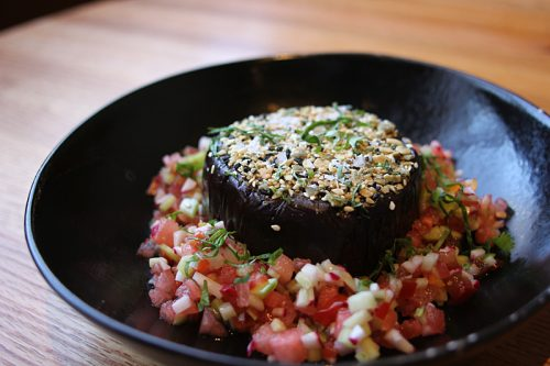 Roasted eggplant with watermelon habanero salsa, pumpkin and sesame seeds