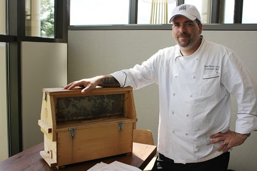 Chef Sean Curry with his box of bees
