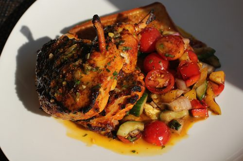 Roast Cameron Farms chicken with panzanella salad of local tomatoes and vegetables, garlic butter