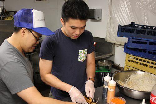Sisavath, left, with Tom Kovotsophon at Tanuki Sushi in Lakeview